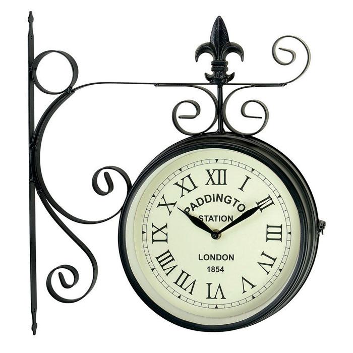 Часы настенные Gardman Paddington на кронштейне, цвет: черный. 1715217152Кварцевые настенные часы Gardman Paddington, выполненные из металла черного цвета, оригинально украсят интерьер помещения, а также прекрасно подойдут для уличного декора. Двухсторонние часы в круглом корпусе выполнены в духе конца 19 века - эпоху развития железных дорог. Часы оформлены римскими цифрами и имеют две стрелки - часовую и минутную. Циферблат желтого цвета оформлен надписью: Paddington Station. London. 1854. Часы крепятся к стене с помощью кронштейна. Часы Gardman Paddington станут замечательным дизайнерским решением для декора сада, дачи или гостиной дома. Характеристики: Материал: металл, пластик, стекло. Цвет: черный. Диаметр циферблата: 22,5 см. Диаметр часов: 27 см. Общий размер часов: 40 см х 43 см х 7 см. Рекомендуется докупить две батарейки типа АА (в комплект не входят). Товары для садоводства от Gardman - это вещи, сделанные с любовью, с истинно английской практичностью, основанной на глубоких...
