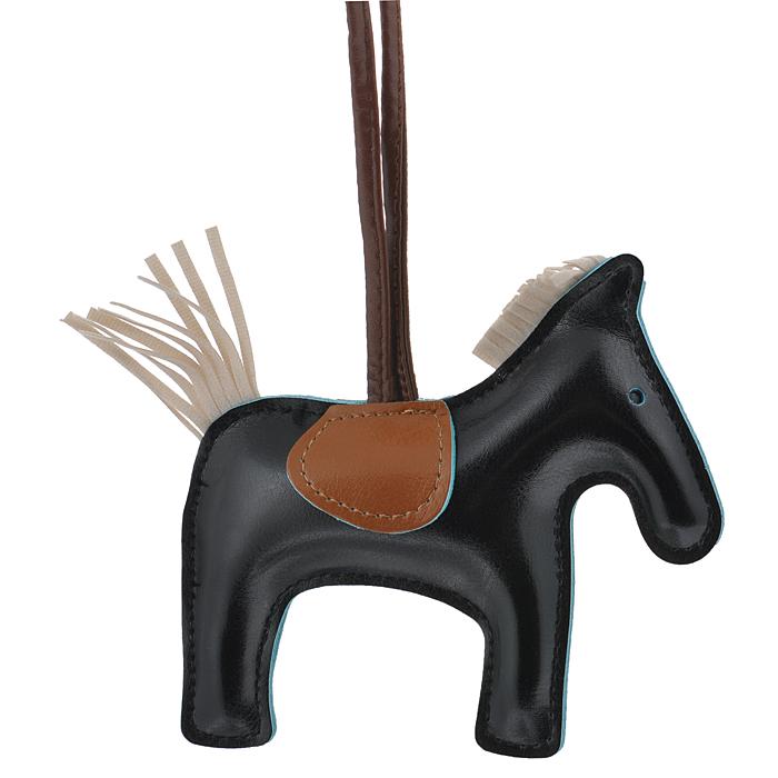 Подвеска на сумку Cheribags, цвет: черный. Лошадка 10Лошадка 10Подвеска Cheribags выполнена из высококачественной экокожи в виде фигурки лошадки. Подвеска оснащена петелькой из кожи, благодаря чему ее можно повесить на сумку. Стильная вещица порадует любительницу ярких и необычных аксессуаров.