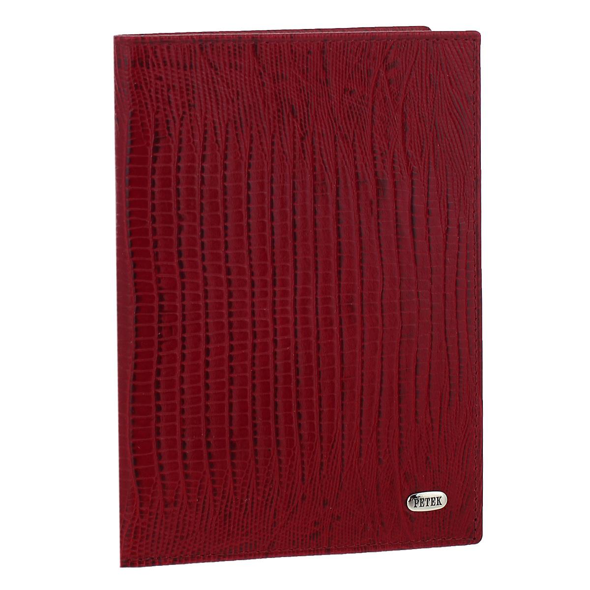 Обложка для паспорта Red, цвет: красный. 651.041.10651.041.10 RedОбложка для паспорта Red выполнена из натуральной лаковой кожи с декоративным тиснением под крокодила. На внутреннем развороте расположено два вертикальных кармана, два кармана с «окошками» из прозрачного пластика, два кармашка для пластиковых карт и один кармашек для бумаг. Обложка не только поможет сохранить внешний вид ваших документов и защитит их от повреждений, но и станет ярким аксессуаром, который подчеркнет ваш образ. Обложка упакована в фирменную картонную коробку. Характеристики: Материал: натуральная кожа, текстиль, пластик. Размер обложки: 9,5 см х 13,5 см х 1,5 см. Цвет: красный.