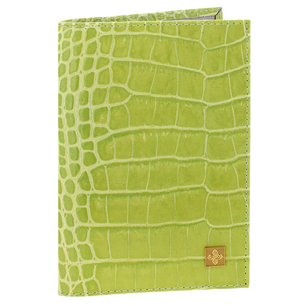 """Обложка для паспорта женская Dimanche Lime, цвет: лайм. 391391Стильная обложка Lime выполнена из натуральной лаковой кожи с фактурным тиснением """"под крокодила"""". На внутреннем развороте расположено два вертикальных кармана из прозрачного пластика. Такая обложка не только поможет сохранить внешний вид ваших документов и защитит их от повреждений, но и станет ярким аксессуаром, который подчеркнет ваш образ. Обложка упакована в подарочную картонную коробку с логотипом фирмы. Характеристики: Материал: натуральная кожа, ПВХ. Размер обложки: 9,5 см х 13,5 см х 1,5 см. Цвет: лайм."""