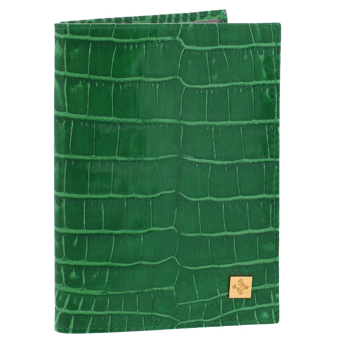 Обложка для паспорта Dimanche Казино, цвет: зеленый. 980980Обложка для паспорта Казино выполнена из натуральной кожи с декоративным тиснением под крокодила. На внутреннем развороте - два кармашка из прозрачного пластика. Обложка не только поможет сохранить внешний вид ваших документов и защитит их от повреждений, но и станет стильным аксессуаром, который подчеркнет ваш неповторимый стиль. Обложка упакована в коробку из плотного картона с логотипом фирмы. Характеристики: Материал: натуральная кожа, ПВХ. Цвет: зеленый Размер обложки: 9,5 см х 13,5 см х 1,5 см.