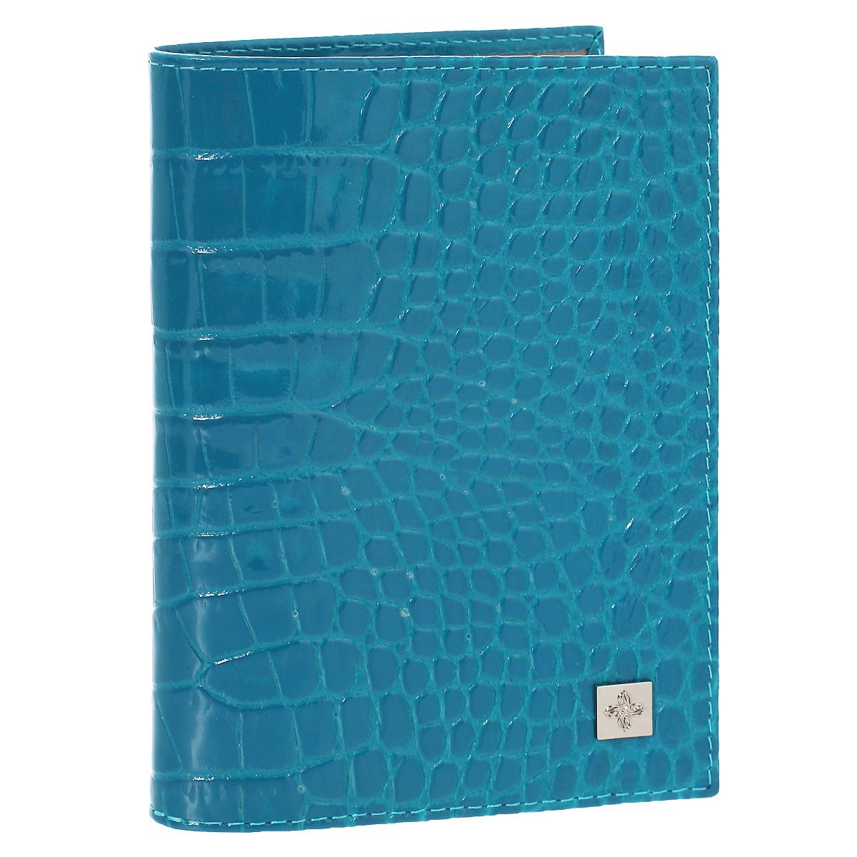 Обложка для паспорта Dimanche Электрик, цвет: лазурь. 950950Обложка для паспорта Электрик выполнена из натуральной лаковой кожи с декоративным тиснением под крокодила. На внутреннем развороте - два кармашка из прозрачного пластика. Обложка не только поможет сохранить внешний вид ваших документов и защитит их от повреждений, но и станет стильным аксессуаром, который подчеркнет ваш неповторимый стиль. Обложка упакована в коробку из плотного картона с логотипом фирмы. Характеристики: Материал: натуральная кожа, ПВХ. Цвет: лазурь. Размер обложки: 9,5 см х 13,5 см х 1,5 см.