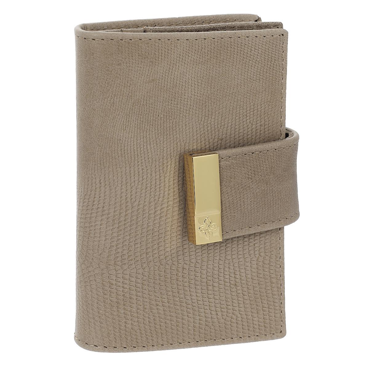 Футляр для кредитных карт Dimanche Elite Beige, цвет: бежевый. 737737Футляр для дисконтных карт Elite Beige выполнен из натуральной мягкой высококачественной кожи с тиснением под кожу варана. Внутри отделение для карт, два накладных кармашка, а также отделение с прозрачным окошком. Футляр закрывается на хлястик с кнопкой. Изделие упаковано в фирменную картонную коробку. Характеристики: Материал: натуральная кожа, текстиль, металл. Цвет: бежевый. Размер футляра: 10,5 см х 7 см х 1,5 см.
