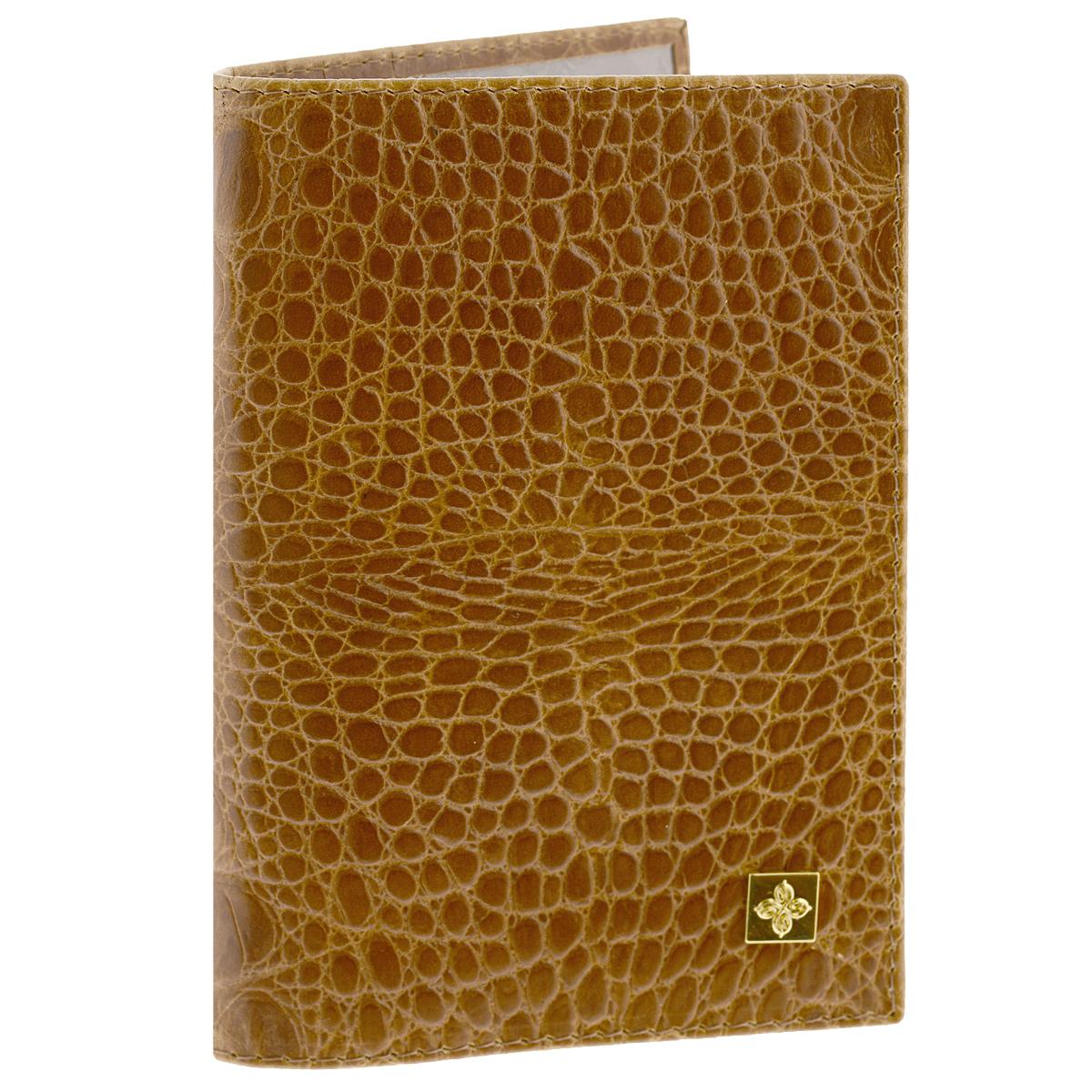 Обложка для паспорта Dimanche Nugget, цвет: горчичный. 900900Обложка для паспорта Nugget выполнена из натуральной кожи с декоративным тиснением под крокодила. На внутреннем развороте - два кармашка из прозрачного пластика. Обложка не только поможет сохранить внешний вид ваших документов и защитит их от повреждений, но и станет стильным аксессуаром, который подчеркнет ваш неповторимый стиль. Обложка упакована в коробку из плотного картона с логотипом фирмы. Характеристики: Материал: натуральная кожа, ПВХ. Цвет: горчичный. Размер обложки: 9,5 см х 13,5 см х 1,5 см.