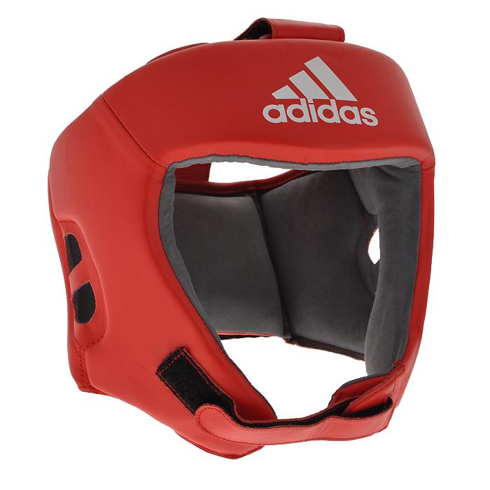Шлем боксерский Adidas AIBA, цвет: красный. AIBAH1. Размер L (52-56 см)AIBAH1Боксерский шлем Adidas AIBA разработан и спроектирован для обеспечения максимальной защиты и оптимальной видимости. Шлем сертифицирован Международной ассоциацией бокса (AIBA). Оболочка шлема изготовлена из натуральной кожи, что увеличивает срок эксплуатации шлема. Внутреннее наполнение из пены, изготовленной по технологии Air Cushion, обеспечивает отличную амортизацию ударных нагрузок. Внутренняя подкладка выполнена из высокотехнологичной, искусственной кожи Amara. Шлем имеет легкую конструкцию без защиты скул. Два широких ремня фиксируемых липучкой на теменной части и два ремня на липучке в затылочной части позволяют регулировать размер шлема и обеспечивают плотную и удобную посадку, исключая смещение шлема во время боя. Так же шлем имеет регулируемый ремешок под подбородком.