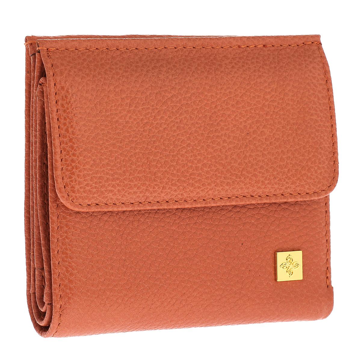 Кошелек женский Dimanche Corail, цвет: оранжевый. 943943Кошелек Dimanche Corail изготовлен из натуральной кожи оранжевого цвета. Закрывается на магнитную кнопку. На передней стенке расположен объемный карман для мелочи, закрывающийся клапаном на кнопку. Внутри кошелька содержится 2 отделения для купюр, дополнительный карман на молнии, 2 прорезных кармана для пластиковых карт, кармашек для сим-карты, 2 потайных вертикальных кармашка для мелких бумаг и окошко для фотографии. Внутри кошелек отделан атласным полиэстером бежевого цвета с узором. Фурнитура - золотистого цвета. Стильный кошелек отлично дополнит ваш образ и станет незаменимым аксессуаром на каждый день. Упакован в фирменную картонную коробку коричневого цвета.