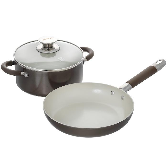Набор посуды Vitesse Athena, с керамическим покрытием, цвет: коричневый, 3 предмета. VS-2239VS-2239Набор посуды Vitesse Athena состоит из кастрюли с крышкой и сковороды. Изделия выполнены из высококачественного алюминия. Внешнее термостойкое покрытие коричневого цвета, подвергшееся высокотемпературной обработке, обеспечивает легкую чистку. Внутреннее керамическое покрытие Eco-Cera белого цвета абсолютно безопасно для здоровья человека и окружающей среды, так как не содержит вредной примеси PFOA и имеет низкое содержание CO в выбросах при производстве. Керамическое покрытие обладает устойчивостью к царапинам и механическим повреждениям. Прочность покрытия позволяет готовить при температуре до 450°С и использовать металлические лопатки. Кроме того, с таким покрытием пища не пригорает и не прилипает к стенкам. Готовить можно с минимальным количеством подсолнечного масла. Посуда быстро разогревается, распределяя тепло по всей поверхности, что позволяет готовить в энергосберегающем режиме, значительно сокращая время, проведенное у плиты. Посуда оснащена...