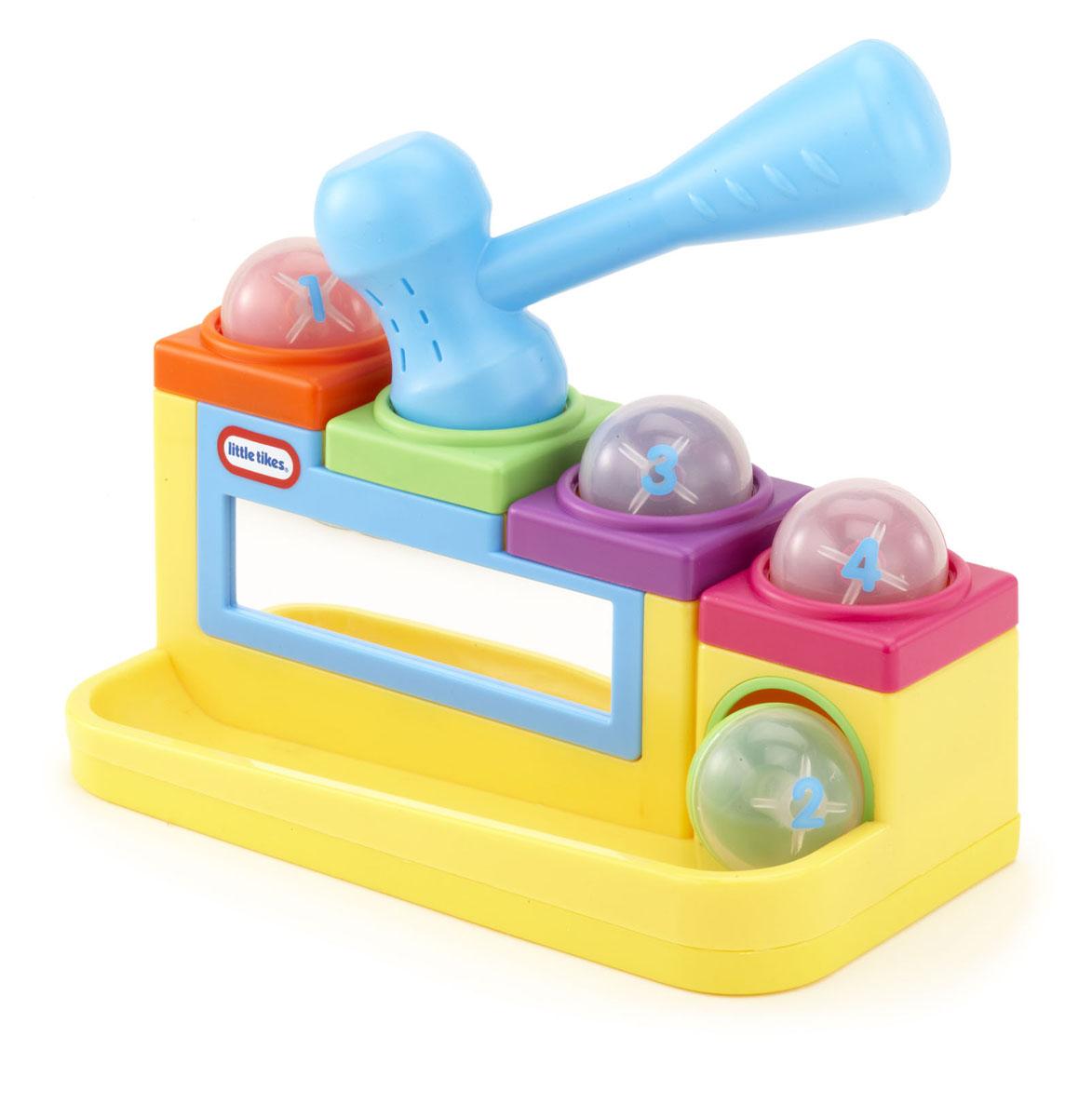 Развивающая игрушка Little Tikes Наковальня634901Развивающая игрушка Little Tikes Наковальня представляет собой пластиковое основание - наковальню с отверстиями, в которые забиваются шарики, проваливаясь и сказываясь по направляющей, для того, чтобы начать играть заново. В комплект входят четыре шарика, молоток и основание-наковальня с четырьмя отверстиями и безопасным зеркалом. Яркая игрушка Little Tikes Наковальня поможет ребенку в развитии пространственного мышления, цветовосприятия, ловкости и координации движений, а также научит различать фигуры.