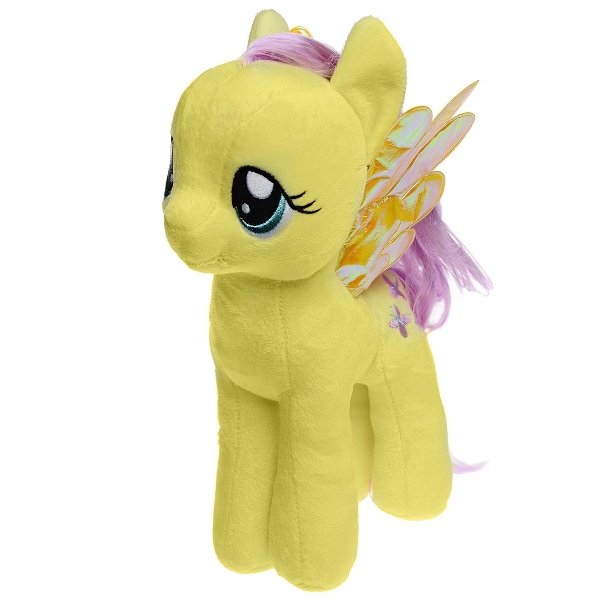 My Little Pony. Мягкая игрушка Пони Fluttershy, 30 см41077Мягкая игрушка Fluttershy выполнена в виде очаровательной пони желтого цвета с длинным хвостом, гривой и волшебными переливающимися крылышками. Игрушка изготовлена из высококачественного текстильного материала с набивкой из синтепона. Грива и хвостик Флаттершай выполнены из мягкого текстиля, их можно заплетать и расчесывать. Игрушка имеет специальные уплотнения в ногах, что позволяет ей стоять самостоятельно, без опоры. Как и все игрушки серии Beanie Buddy, она изготовлена вручную, с любовью и вниманием к деталям. Флаттершай - очень нежная, робкая и застенчивая. А еще она - самая добрая лошадка в Понивилле! Она очень любит животных и умеет с ними разговаривать, а дома у нее живет целая компания забавных питомцев. Удивительно мягкая игрушка принесет радость и подарит своему обладателю мгновения нежных объятий и приятных воспоминаний. Специальные гранулы, используемые при ее набивке, способствуют развитию мелкой моторики рук малыша Великолепное качество исполнения...
