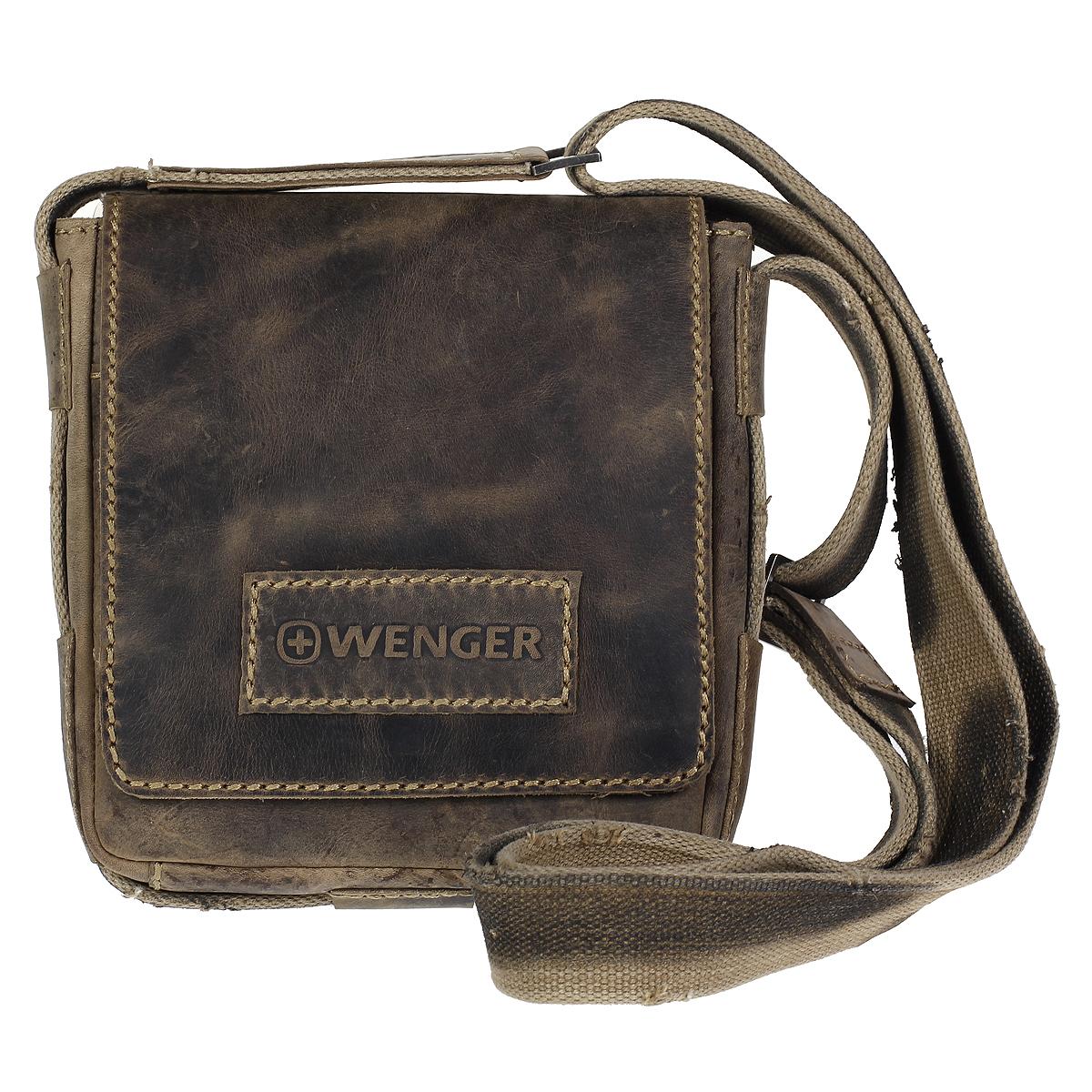 Сумка-планшет мужская Wenger Stonehide, цвет: светло-коричневый. W16-01W16-01Сумка-планшет Wenger Stonehide выполнена из крепкой эластичной бычьей кожи, обработанной по традиционной технологии - грубые швы, состаренные ремни. Такая сумка будет уместна везде - на деловой встрече, учебе или работе. Сумка имеет одно отделение и закрывается широким клапаном на магнитную кнопку. Внутри - вшитый карман на молнии, шесть кармашков для кредиток или визитных карточек, два держателя для пишущих инструментов, карман для мобильного телефона и открытый накладной кармашек для мелочей. На задней стенке - вшитый карман на молнии. Сумка-планшет оснащена текстильным плечевым ремнем регулируемой длины. Стильная, практичная и компактная сумка-планшет в стиле кэжуал - для современного мужчины. Кожаные сумки Wenger - модные, функциональные, высококачественные сумки с уникальным дизайном. По всем вопросам гарантийного и постгарантийного обслуживания рюкзаков, чемоданов, спортивных и кожаных сумок, а также портмоне марок Wenger и SwissGear вы...