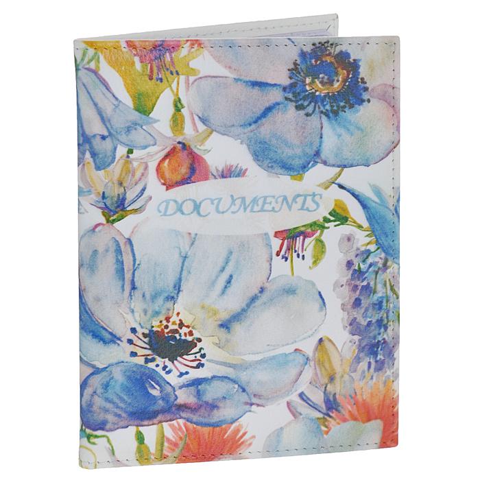 Обложка для автодокументов Perfecto Голубые цветы-2. VD-PT-23VD-PT-23Обложка для автодокументов Perfecto Голубые цветы-2 изготовлена из натуральной кожи с изящным цветочным рисунком. Внутри содержится съемный блок из 6 прозрачных пластиковых файлов разного размера, а также 4 прорезных кармана для пластиковых карт. Обложка не только поможет сохранить внешний вид ваших документов и защитить их от повреждений, но и станет стильным аксессуаром, идеально подходящим вашему образу. Обложка для документов стильного дизайна может быть достойным и оригинальным подарком.