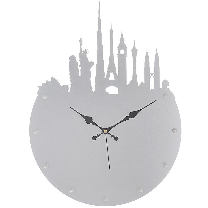 Часы настенные Башни, цвет: серебристый. 9518295182Изящные настенные часы Башни эффектно украсят интерьер помещения. Дизайн, полный хрупкого изящества, в этих часах удачно сочетается с высокой прочностью материалов. Корпус выполнен из коррозионностойкой стали с порошковым напылением серебристого цвета. Несмотря на устойчивый к механическим воздействиям корпус, часы выглядят ажурными, словно вырезанными из бумаги. Постоянное движение секундной стрелки придает фигуркам в виде самых знаменитых башен мира иллюзию постоянного трепета. Механизм часов - кварцевый. С задней стороны корпуса имеется отверстие для подвешивания на стену. Красивые и качественные настенные часы украсят современный интерьер и порадуют надежной работой.