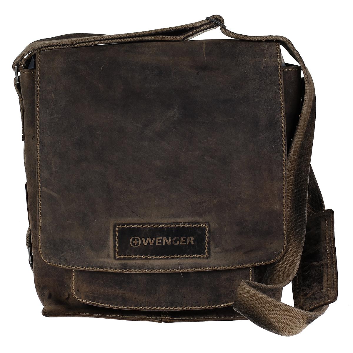 Сумка мужская Wenger Stonehide, цвет: светло-коричневый. W16-03W16-03Мужская сумка в стиле casual Wenger Stonehide изготовлена из высококачественной натуральной кожи светло-коричневого цвета. Кожа серии Stonehide - это крепкая, эластичная бычья кожа, обработанная по традиционной технологии - грубые швы, состаренные ремни. Потертый внешний вид делает изделие уникальным и создает специфический эффект старины. Сумка по всей поверхности оформлена стежками бежевого цвета. Сумка имеет одно основное отделение, которое закрывается клапаном на две магнитные кнопки. Внутри содержится два накладных кармашка, два держателя для ручек, вшитый карман на молнии и 6 кармашков для пластиковых карт или визиток. Имеет мягкую внутреннюю обивку из полиэстера коричневого цвета, позволяющую при переноске сохранять планшеты и телефоны без повреждений. Под клапаном содержится открытое отделение для планшета и вшитый карман на молнии. С задней стороны сумки расположено дополнительное отделение на молнии. Изделие оснащено плечевым ремнем регулируемой длины из плотного...