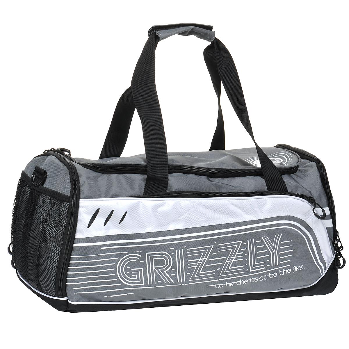 Сумка спортивная Grizzly, цвет: серый, черный. TU-415-2/3TU-415-2 Сумка спортивная /3 серыйСпортивная сумка Grizzly выполнена из полиэстера серого цвета и оформлена принтом. Сумка состоит из одного вместительного отделения, закрывающегося на застежку-молнию. Внутри карман на молнии. На лицевой стороне расположен вшитый кармашек на молнии. По бокам сумка имеет дополнительные карманы на молнии и карман сетку. Сумка оснащена двумя текстильными ручками, а также съемным плечевым ремнем регулируемой длины. Дно сумки уплотненное и оборудовано пластиковыми ножками для защиты сумки от загрязнения. Такая сумка идеально подойдет для поездок и походов в спортивный зал, в нее можно положить все необходимое.