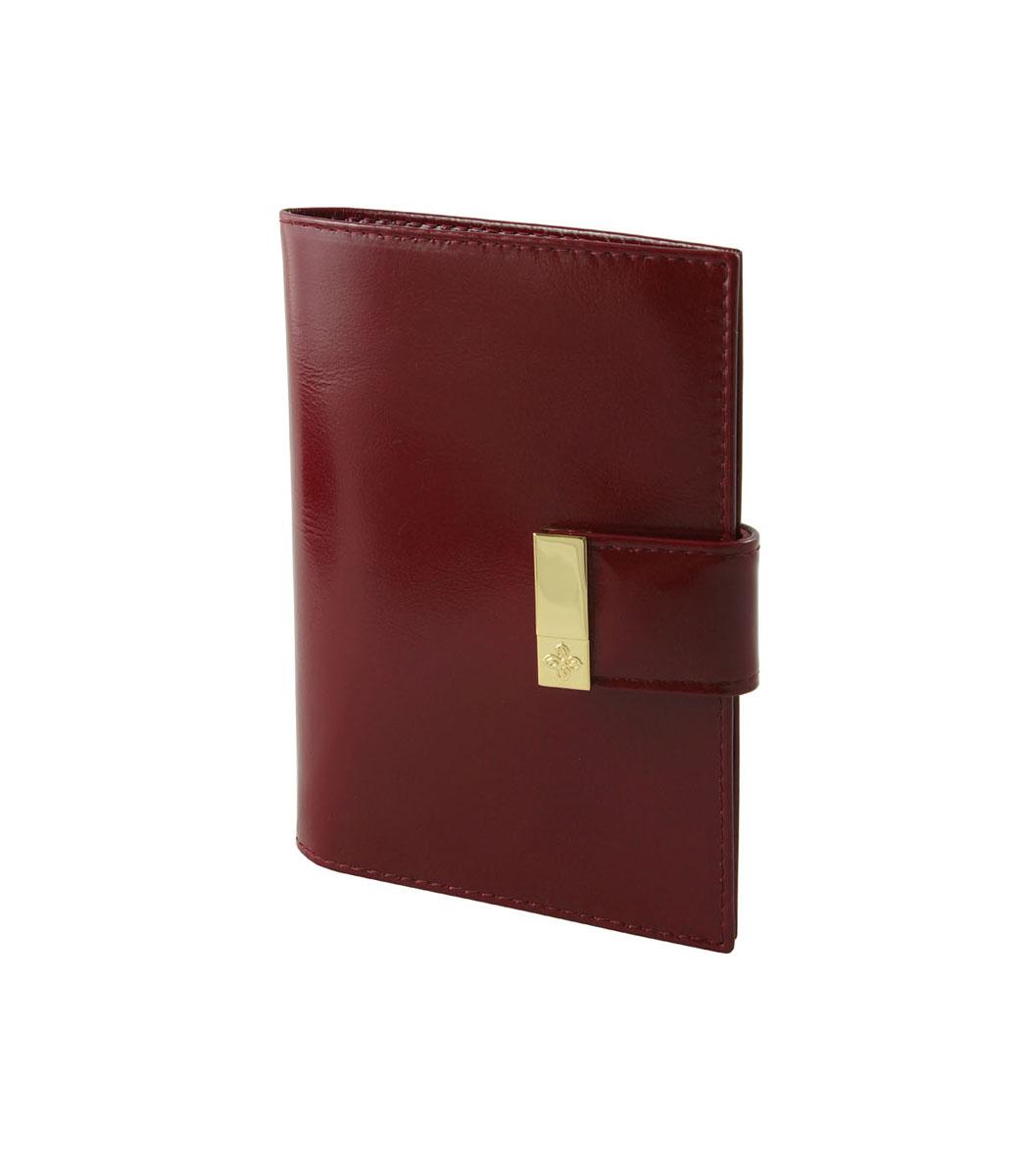 Обложка для паспорта Dimanche Elite Гранат, цвет: бордовый. 150150Обложка для паспорта Dimanche Elite Гранат изготовлена из натуральной кожи бордового цвета. Внутри содержится два прозрачных захвата для паспорта. Внутренняя отделка - из стильной ткани насыщенного красного цвета. Закрывается обложка на кнопку хлястиком с металлическим украшением. Обложка Dimanche Elite Гранат не только поможет сохранить внешний вид вашего паспорта и защитит его от повреждений, но и станет ярким аксессуаром, который подчеркнет ваш неповторимый стиль. Обложка упакована в фирменную подарочную коробку.