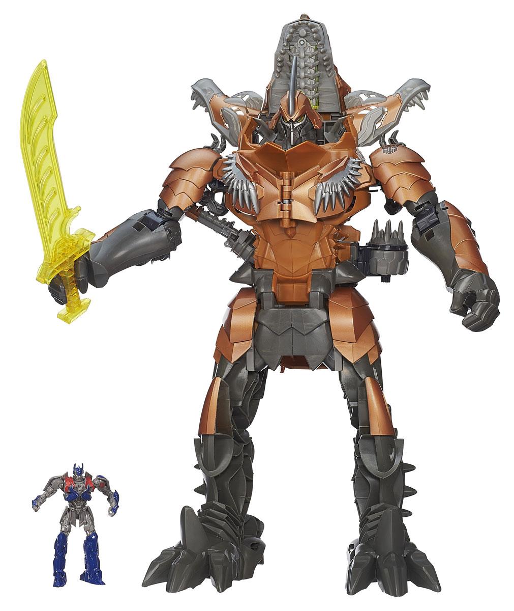 Transformers: GrimlockA6145Игрушка Transformers Grimlock понравится вашему маленькому поклоннику Трансформеров и не позволит ему скучать. Она выполнена из прочного пластика в виде персонажа из нового фильма Трансформеры 4. Эпоха истребления Гримлока - самого мощного из диноботов. Робот с грозным оружием может трансформироваться в рычащего тираннозавра, у которого светятся глаза. В комплект входит фигурка трансформера Оптимуса Прайма, который выступает в качестве наездника. Ваш ребенок часами будет занят игрой, придумывая разные истории. Порадуйте его таким замечательным подарком! Рекомендуется докупить 2 батарейки напряжением 1,5V типа AАA (товар комплектуется демонстрационными).