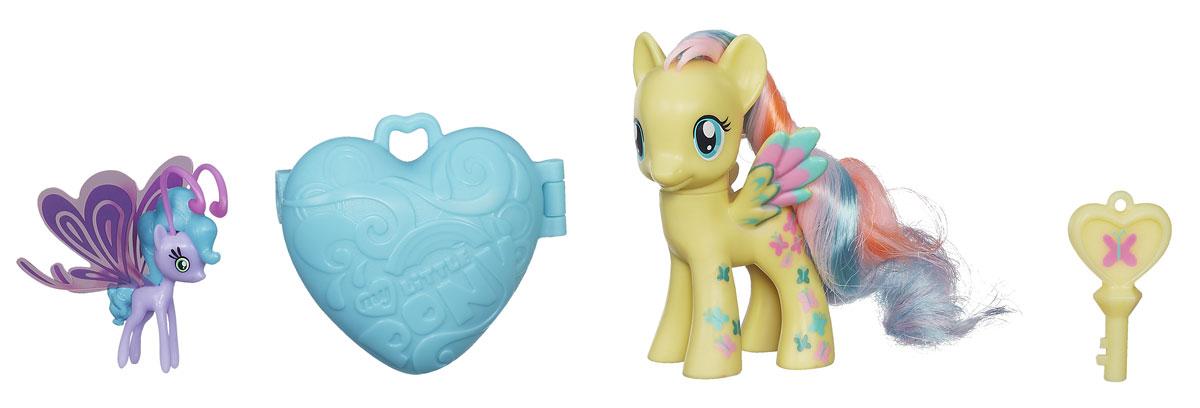 My Little Pony Пони с сердечком Флаттершай и Сиа БризB3598EU4_ФлаттершайНабор My Little Pony Пони с сердечком. Флаттершай и Сиа Бриз понравится вашей маленькой принцессе. В наборе сердечко, которое открывается волшебным ключиком - совсем как в мультфильме Дружба - это чудо! У пони Флаттершай неоновая грива и радужные элементы дизайна! А так же маленький волшебный друг Сиа Бриз из расы Бризи. Порадуйте свою малышку таким великолепным подарком!