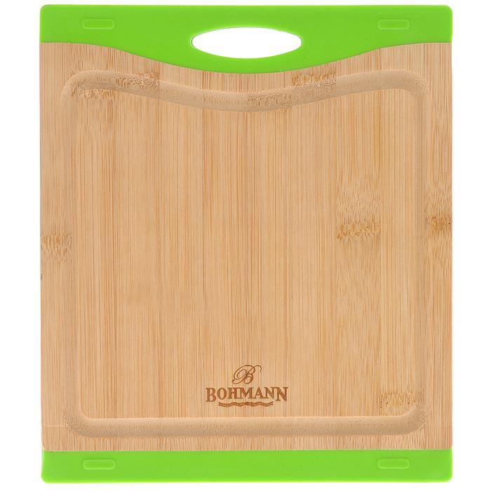 Доска разделочная Bohmann, бамбуковая, 23 см х 20,5 см. 02502BH02502BHРазделочная доска Bohmann изготовлена из бамбука. Бамбук - это абсолютно экологически чистый материал, который в первую очередь ценится за свою устойчивость к сильным нагрузкам и обладает повышенной влагостойкостью. Поверхность бамбуковых досок твердая и гладкая. Кроме того, такие доски обладают хорошими водоотталкивающими и антибактериальными свойствами. Доска не впитывает влагу, легко моется, не деформируется. Может использоваться как подставка под горячее. Благодаря вставкам из силикона доска не скользит по столу. Доска оснащена желобками, куда стекает лишняя жидкость при нарезке продуктов. Не рекомендуется мыть в посудомоечной машине.