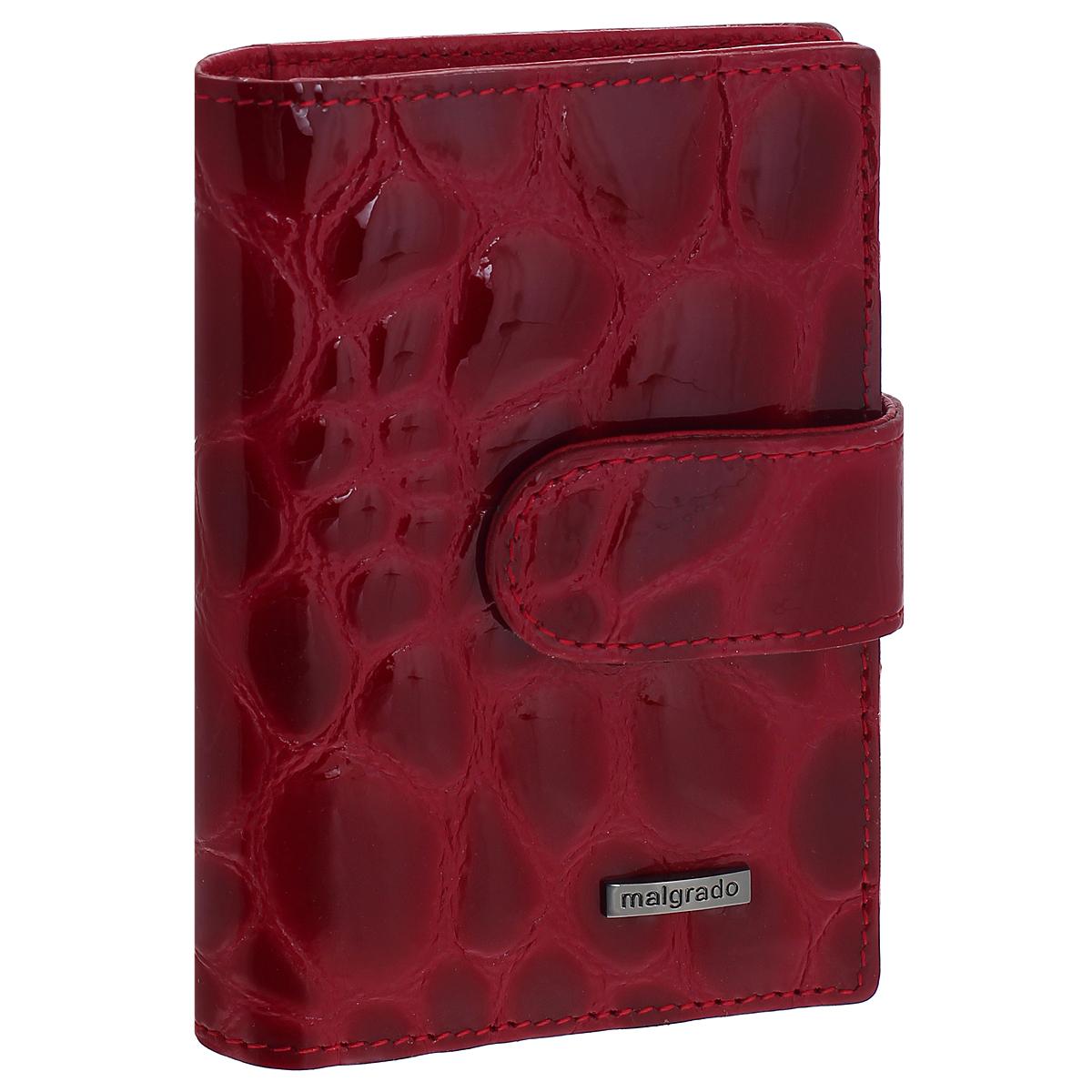 Визитница Malgrado, цвет: красный. 42003-1N-3840242003-1N-38402Стильная визитница Malgrado с веерным открытием изготовлена из натуральной кожи с тиснением под rhjrjlbkf. Внутри содержит прозрачный вкладыш с двадцатью отделениями для кредитных и дисконтных карт. На боковых стенках имеются два дополнительных отделения для пропуска и карт. Закрывается визитница на клапан, на одну из двух кнопок. Такая визитница станет замечательным подарком человеку, ценящему качественные и практичные вещи.