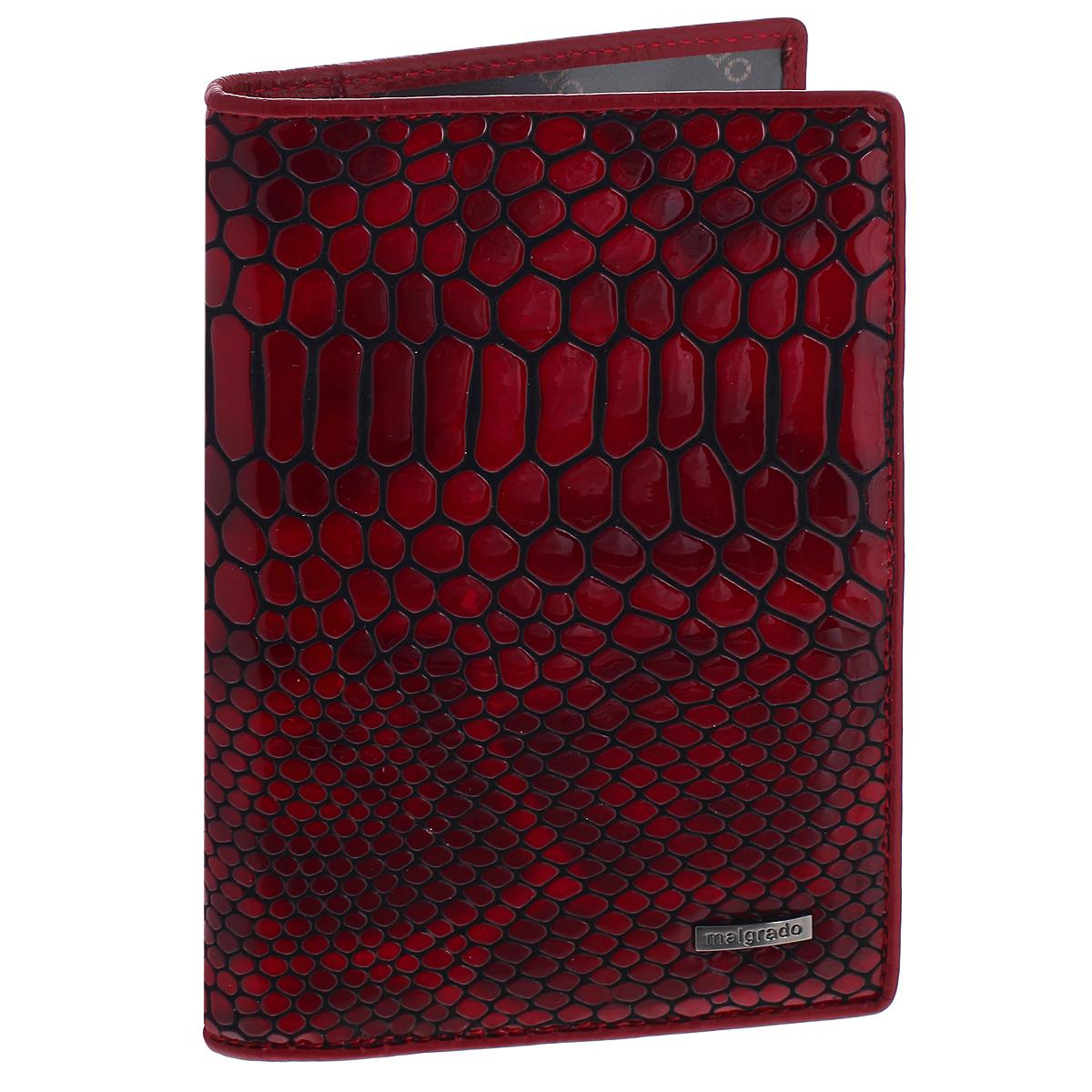 Обложка для документов Malgrado, цвет: бордовый, черный. 54019-1A-4030254019-1A-40302Стильная обложка для документов Malgrado, выполненная из натуральной кожи с тиснением под рептилию. Обложка может послужить как для хранения автодокументов, так и паспорта. Внутри содержится съемный блок из 4 прозрачных файлов для автодокументов. Также имеется 5 кармашков для визиток и пластиковых карт. Обложка поможет сохранить внешний вид ваших документов и защитит их от повреждений, а также станет стильным аксессуаром, который подчеркнет ваш образ. Обложка упакована в подарочную коробку синего цвета с логотипом фирмы.