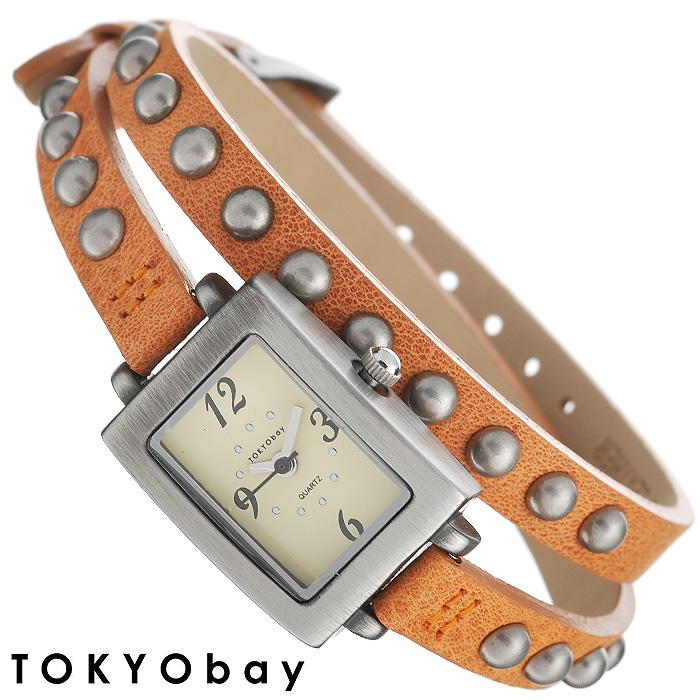 Часы женские наручные Tokyobay Armor. TL753-ORTL753-ORНаручные женские часы Tokyobay Armor - это стильное дополнение к вашему неповторимому образу. Эти часы созданы для девушек и женщин, ценящих стиль, качество и практичность. Часы оснащены японским кварцевым механизмом MIYOTA. Корпус прямоугольной формы выполнен из металла серебристого цвета, не содержащего никель. Задняя крышка изготовлена из нержавеющей стали. Циферблат бежевого цвета имеет две стрелки - часовую и минутную. Циферблат защищен ударопрочным оптическим пластиком. Ремешок, выполненный из натуральной кожи оранжевого цвета, отделан металлическими клепками. Застегивается на классическую застежку. Длинный ремешок обхватывает запястья два раза, что смотрится особенно стильно и актуально. Часы Tokyobay - это практичный и модный аксессуар, который оценит любая девушка.