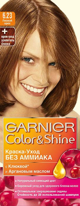 Garnier Краска-уход для волос Color&Shine без аммиака, оттенок 6.23, Лесной орех, 110 млC2854511Garnier Color&Shineкраска-уход, без аммиака, которая не только бережно ухаживает за волосами, делая их мягкими, но и оптимально закрашивает седину. Она обогащена экстрактом клюквы, признанным антиоксидантом, который продлевает сияние цвета Ваших волос надолго. Благодаря питательным свойствам арганового масла Ваши волосы защищены от сухости, а блеск максимально усилен. Ваши волосы несравненно мягкие, цвет сияющий,стойкий в течение 28 использований шампуня. Узнай больше об окрашивании на http://coloracademy.ru/. В упаковки содержится: флакон с молочком-проявителем (60 мл); тюбик с крем-краской (40 мл); крем-уход усилитель блеска после окрашивания; инструкция; пара перчаток.