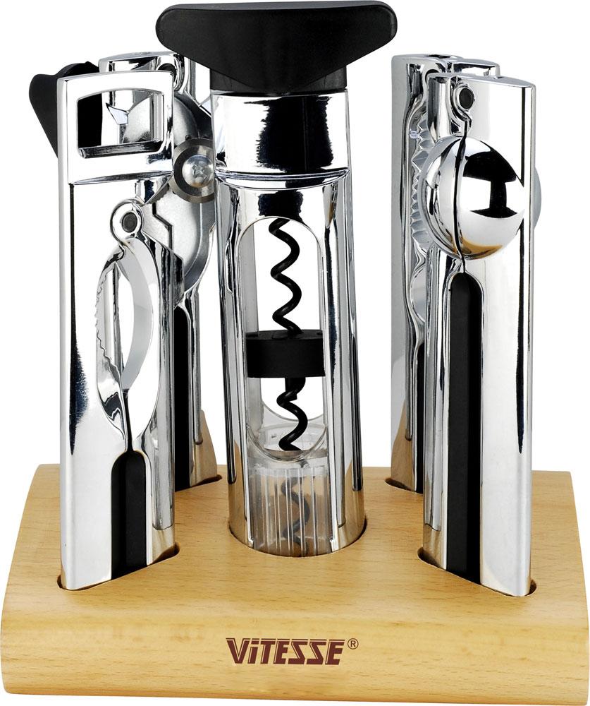 Набор кухонных принадлежностей Vitesse, 5 предметов. VS-1975VS-1975В набор кухонных принадлежностей Vitesse входит консервный ключ, пресс для чеснока, штопор, открывалка для бутылок, щипцы для колки орехов. Предметы набора изготовлены из нержавеющей стали с превосходно отполированным хромированным покрытием. Удобные ручки снабжены пластиковыми вставками. Предметы набора располагаются стильной деревянной подставке. Надежные и удобные в использовании кухонные принадлежности Vitesse пригодятся в каждом доме и станут замечательным практичным подарком друзьям и близким. Можно мыть в посудомоечной машине.