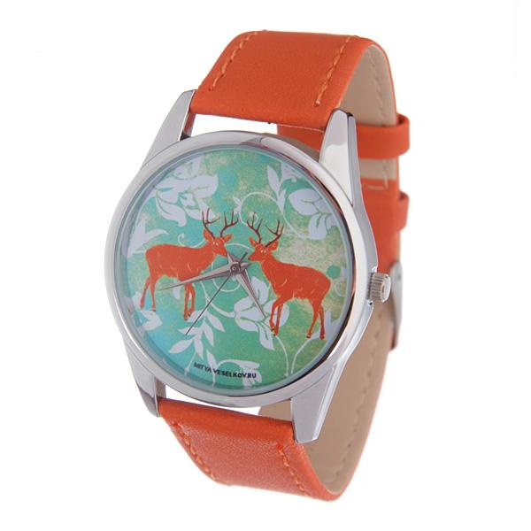 Часы Mitya Veselkov Два оленя (рыжий). Color-58Color-58Наручные часы Mitya Veselkov Два оленя созданы для современных людей, которые стремятся выделиться из толпы и подчеркнуть свою индивидуальность. Часы оснащены японским кварцевым механизмом. Ремешок выполнен из натуральной кожи рыжего цвета, корпус изготовлен из стали серебристого цвета. Циферблат оформлен оригинальным изображением. Часы размещаются на специальной подушечке и упакованы в фирменный стакан Mitya Veselkov.