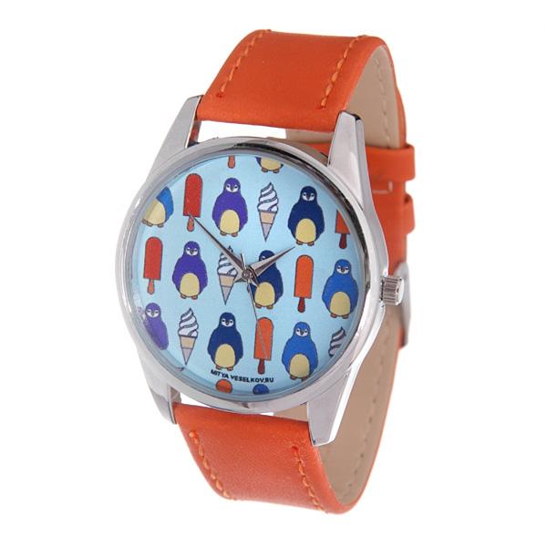 Часы Mitya Veselkov Пингвины и эскимо (оранжевый). Color-61Color-61Наручные часы Mitya Veselkov Пингвины и эскимо созданы для современных людей, которые стремятся выделиться из толпы и подчеркнуть свою индивидуальность. Часы оснащены японским кварцевым механизмом. Ремешок выполнен из натуральной кожи оранжевого цвета, корпус изготовлен из стали серебристого цвета. Циферблат оформлен оригинальным изображением. Часы размещаются на специальной подушечке и упакованы в фирменный стакан Mitya Veselkov.
