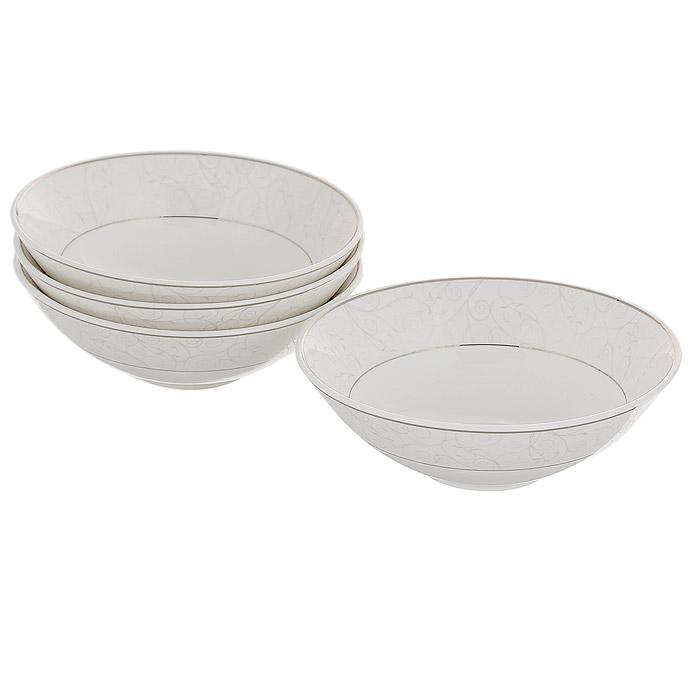 Набор салатников Esprado Florestina, диаметр 16 см, 4 штFL70D16E305Набор Esprado Florestina состоит из четырех салатников, выполненных из высококачественного твердого фарфора. Особое качество твердый фарфор, из которого делается посуда Esprado, имеет благодаря использованию в его изготовлении специального материала - каолина. Каолин - это сорт белой глины, впервые открытый в Китае, который обладает идеальными для производства твердого фарфора свойствами, а именно высокой пластичностью и тугоплавкостью. Посуда из твердого фарфора имеет надглазурную роспись, которая отличается богатой цветовой палитрой, что позволяет воплощать самые яркие идеи. В процессе обжига при температуре в 800°С используется природный газ, а не уголь - это сохраняет глазурь чистой и прозрачной, а саму процедуру делает экологически чистой. Над созданием дизайна коллекций посуды из твердого фарфора Esprado работает международная команда высококлассных дизайнеров, не только воплощающих в жизнь все новейшие тренды, но также и придерживающихся многовековых...