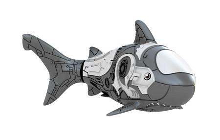 Игрушка для ванны Robofish РобоРыбка: Акула, цвет: серый2501-5Игрушка для ванны Robofish РобоРыбка: Акула понравится вашему малышу и превратит купание в веселую игру. Она выполнена из безопасного пластика с элементами металла в виде маленькой красочной акулы. При погружении в ванну, аквариум или другую емкостью с водой РобоРыбка начинает плавать, опускаясь ко дну и поднимаясь к поверхности воды. Акула прекрасно имитирует повадки настоящей рыбы. Траектория ее движения зависит от наклона хвоста. Внутри рыбки находится специальный грузик, регулирующий глубину ее погружения. Если рыбка плавает на дне, не всплывая, - уберите грузик; если на поверхности - добавьте грузик. Набор включает подставку, на которой можно разместить рыбку, пока вы с ней не играете. Порадуйте вашего ребенка таким замечательным подарком! Игрушка работает от 2 батарей напряжением 1,5V типа LR44 (2 установлены в игрушку и 2 запасные).