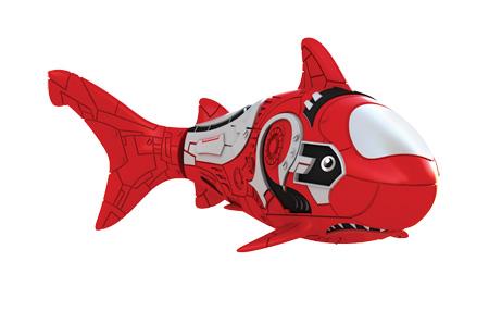 Игрушка для ванны Robofish РобоРыбка: Акула, цвет: красный2501-8Игрушка для ванны Robofish РобоРыбка: Акула понравится вашему малышу и превратит купание в веселую игру. Она выполнена из безопасного пластика с элементами металла в виде маленькой красочной акулы. При погружении в ванну, аквариум или другую емкостью с водой РобоРыбка начинает плавать, опускаясь ко дну и поднимаясь к поверхности воды. Акула прекрасно имитирует повадки настоящей рыбы. Траектория ее движения зависит от наклона хвоста. Внутри рыбки находится специальный грузик, регулирующий глубину ее погружения. Если рыбка плавает на дне, не всплывая, - уберите грузик; если на поверхности - добавьте грузик. Набор включает подставку, на которой можно разместить рыбку, пока вы с ней не играете. Порадуйте вашего ребенка таким замечательным подарком! Игрушка работает от 2 батарей напряжением 1,5V типа LR44 (2 установлены в игрушку и 2 запасные).