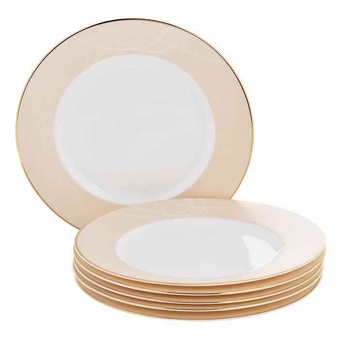 Набор десертных тарелок Esprado El Gracio, диаметр 20 см, 6 штEG40B20E301Набор Esprado El Gracio состоит из шести десертных тарелок, выполненных из костяного фарфора. Основная составляющая костяного фарфора - костная зола и каолин. От содержания костной золы зависит белизна и прозрачность фарфора, который может содержать до 50% костяной золы. Родина костной золы, из которой производится посуда Esprado, - Великобритания, славящаяся сырьем высокого качества. Каолин, белая глина на основе природного минерала, поступает из Новой Зеландии, одного из наиболее экологически чистых регионов мира. Такое сочетание обеспечивает высокое качество материала и безупречный оттенок слоновой кости. В костяном фарфоре отсутствуют примеси кадмия и свинца, а потому он абсолютно нетоксичен и безопасен. Экологическая глазурь из Японии, высоко ценящаяся во всем мире, которой покрывается готовое изделие, позволяет добиться идеально ровного цвета и кристального блеска. При декорировании использованы драгоценные металлы, в том числе платина и золото. Изделия серии...