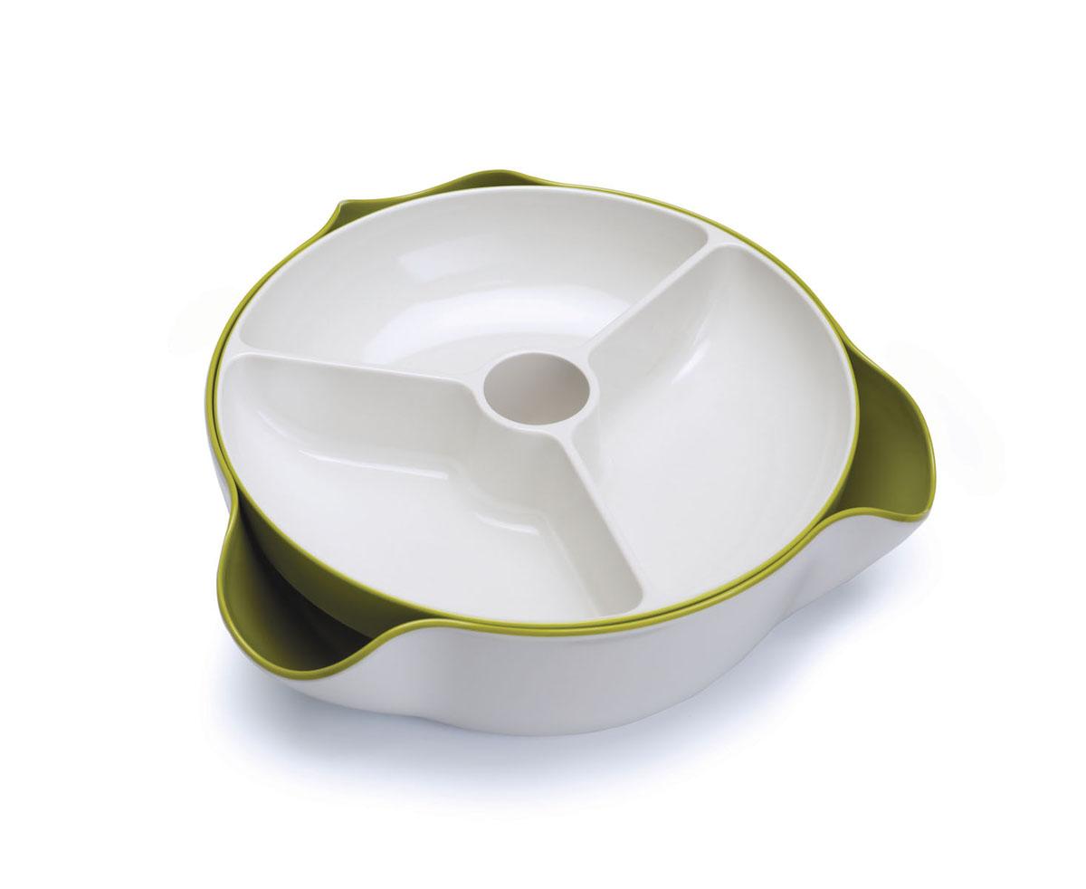 Блюдо для снека Double Dish, цвет: белый, зеленый. 7007370073Блюдо для снека Double Dish, выполненное из пластика и меламина, это отличное решение для сервировки стола. Фисташки, оливки, конфеты или любая другая закуска красиво расположатся на верхнем блюде, а скорлупа и фантики спрячутся внизу. Две тарелочки можно использовать и отдельно друг от друга. Можно мыть в посудомоечной машине.
