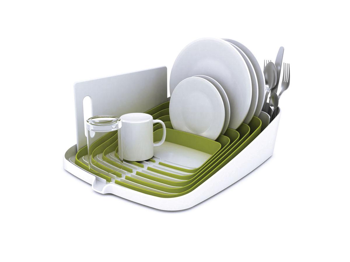 Сушилка для посуды и столовых приборов Joseph Joseph Arenа, со сливом, цвет: белый, зеленый85002Сушилка Joseph Joseph Arenа, выполненная из пластика, имеет инновационный дизайн, который выделяет ее среди других сушилок. Сушилка оснащена специальными ячейками для тарелок, увеличенным количеством ячеек для столовых приборов, а также местом для хранения кружек. Посуда не царапается и не падает в сторону. Тарелки плотно стоят в своих ячейках. Специальный носик позволяет сливаться жидкости прямо в раковину. Дно сушилки оснащено устойчивыми ножками. Сушилка Joseph Joseph Arenа займет достойное место на вашей кухне.