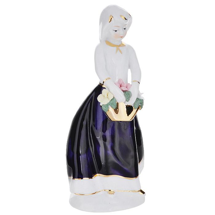 Фигурка декоративная Molento Софи, высота 20 см554-238Декоративная фигурка Molento Софи, изготовленная из высококачественного фарфора, выполнена в виде девушки. Такая фигурка станет отличным дополнением к интерьеру. Вы можете поставить фигурку в любом месте, где она будет удачно смотреться, и радовать глаз. Кроме того, фигурка Софи станет чудесным сувениром для ваших друзей и близких.