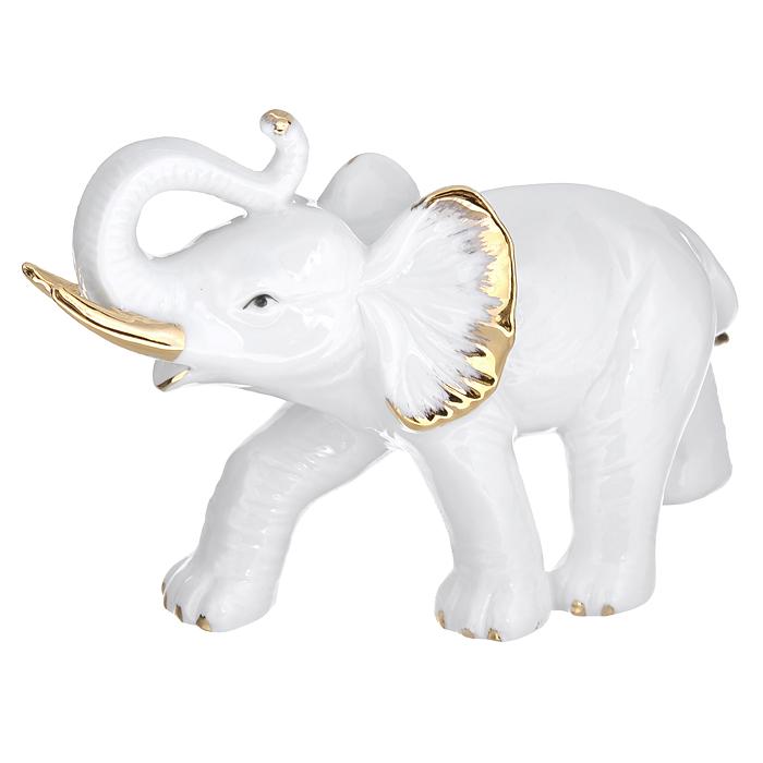 Фигурка декоративная Слон, высота 12 см554-132Декоративная фигурка выполнена из фарфора в виде слона. Эта фигурка является поистине произведением искусства, она воплощает креативное мышление современных дизайнеров и древнейшие традиции итальянских мастеров. Такая фигурка станет отличным дополнением к интерьеру. Вы можете поставить ее в любом месте, где она будет удачно смотреться, и радовать глаз.