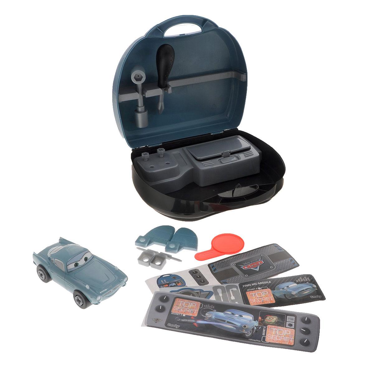 Игрушка-конструктор Smoby Тачки: Финн, в чемоданчике500166Игрушка-конструктор Smoby Тачки: Финн обязательно привлечет внимание вашего малыша. В комплект входят 3 листа с наклейками для оформления чемоданчика, машинка-конструктор, панель-контейнер, дополнительные элементы машинки: 2 крыла, 2 автомата, 2 болта, а также отвертка, баллонный ключ и лупа-проявитель. Направьте лупу на изображение на наклейках - и увидите скрытое изображение. При помощи пластиковой отвертки игрушку можно разбирать и собирать множество раз, как конструктор. Игрушка выполнена из прочного пластика ярких цветов. Все элементы конструктора имеют увеличенные размеры и малыш сможет легко собрать их самостоятельно. Колесики машинки вращаются. Все элементы конструктора упакованы в удобный чемоданчик, на внутренней стороне которого расположена пластиковая стойка для инструментов. С такой игрушкой ваш ребенок весело проведет время, играя на детской площадке или в песочнице. А процесс сборки игрушки-конструктора поможет малышу развить мелкую моторику...