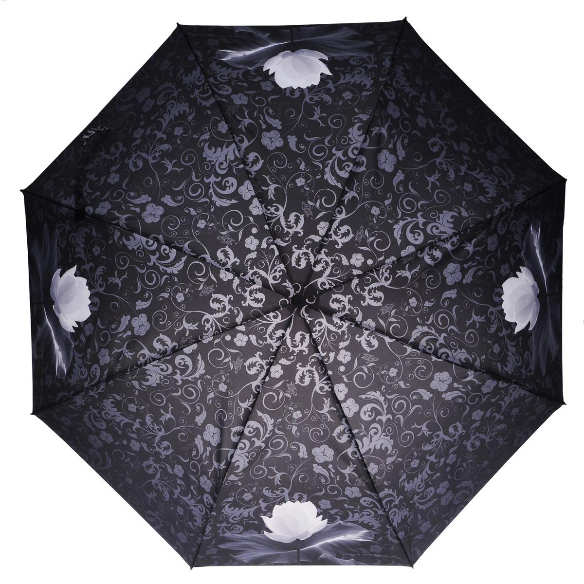Зонт женский Zest, автомат, 3 сложения, цвет: черный. 23745-010823745-0108Элегантный автоматический зонт Zest в 3 сложения изготовлен из высокопрочных материалов. Каркас зонта состоит из 8 спиц из фибергласса и прочного алюминиевого стержня. Специальная система Windproof защищает его от поломок во время сильных порывов ветра. Купол зонта выполнен из прочного полиэстера с водоотталкивающей пропиткой и оформлен витиеватым растительным узором, а также изображением кувшинок. Используемые высококачественные красители обеспечивают длительное сохранение свойств ткани купола. Рукоятка, разработанная с учетом требований эргономики, выполнена из пластика. Зонт имеет полный автоматический механизм сложения: купол открывается и закрывается нажатием кнопки на рукоятке, стержень складывается вручную до характерного щелчка. Благодаря этому открыть и закрыть зонт можно одной рукой, что чрезвычайно удобно при входе в транспорт или помещение. Небольшой шнурок, расположенный на рукоятке, позволяет надеть изделие на руку при необходимости. Модель закрывается при...