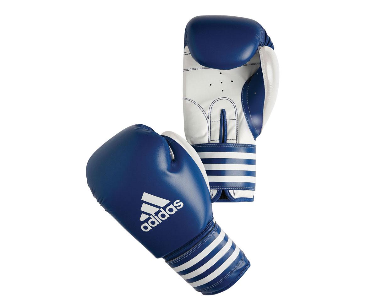 Перчатки боксерские adidas Ultima Competition, цвет: сине-белый. adiBC02adiBC02Боксерские перчатки adidas Ultima Competition для отработок ударов и комбинаций. Тыльная сторона в перчатках выполнена из прочной, износостойкой, натуральной кожи. Внутренний наполнитель, выполненный из формованной под давлением пены с интегрированной внутренней вставкой из геля, выполненной по технологии I-Protech, покрывает тыльную сторону, создавая надежную защиту рук и давая боксеру возможность безопасно тренироваться в полную силу. Внутренняя подкладка, выполненная из дышащего материала, и вентиляционное отверстие на ладони создают комфортный микроклимат внутри перчаток. Эластичный ремешок с фиксацией на липучке позволяет быстро одеть и снять перчатки.