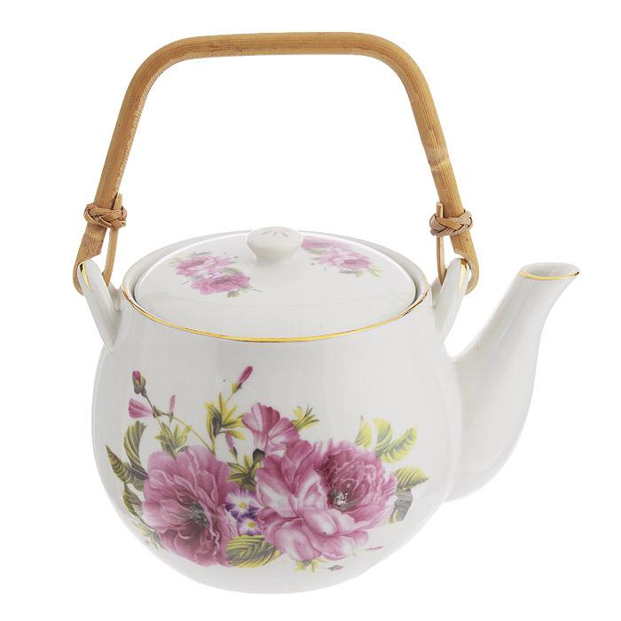 Чайник заварочный Briswild Волшебная роза, с бамбуковой ручкой, 800 мл. 523-126523-126Чайник заварочный Briswild Волшебная роза изготовлен из высококачественного белого фарфора. Чайник декорирован цветочным узором и золотой каймой по краю. Отличительной особенностью этого чайника является съемная деревянная ручка. Такой дизайн, несомненно, придется по вкусу и любителям классики, и тем, кто ценит красоту и изящество. Чайник заварочный Briswild Волшебная роза украсит ваш кухонный стол, а также станет замечательным подарком к любому празднику. Не использовать в микроволновой печи. Не применять абразивные чистящие вещества. Диаметр по верхнему краю: 10 см. Диаметр основания чайника: 7,5 см. Высота чайника (без учета крышки): 9,5 см.