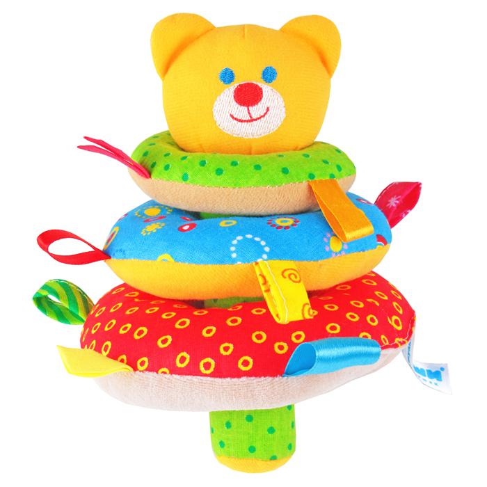 Мякиши Мягкая игрушка-пирамидка Мишка322Мягкая игрушка-пирамидка Мякиши Мишка надолго займет внимание вашего крохи. На штырек основания пирамидки насаживается три колечка разных цветов и размеров с небольшими петельками на каждом. Шуршащий штырек венчает головка забавного медвежонка с вышитой мордашкой. Внутри головки спрятана сфера с шариками, гремящими при тряске. Внутри большого колечка также находится гремящая сфера. Игрушка выполнена из качественных, приятных на ощупь текстильных разнофактурных материалов и мягкого наполнителя, что делает ее абсолютно безопасной в игре. Удачно подобранный размер и цвет развивают мышление, цветовое и слуховое восприятие, координацию движений и совершенствуют моторику нежных пальчиков малыша. УВАЖАЕМЫЕ КЛИЕНТЫ! Обращаем ваше внимание на возможные изменения в дизайне товара: цвет отдельных элементов может отличаться от представленного на изображении. Поставка осуществляется в зависимости от наличия на складе.