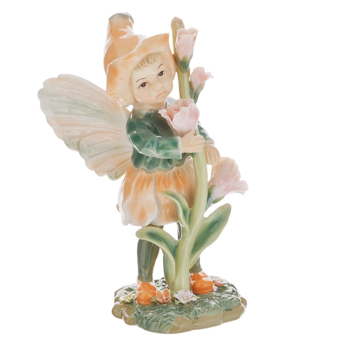 Статуэтка Navel Девочка-фея в оранжевом, высота 20,5 смN-PB0177/A-ALОчаровательная статуэтка Девочка-фея в оранжевом станет оригинальным подарком для всех любителей стильных вещей. Она выполнена из фарфора, покрытого глазурью в нежных зеленых и оранжевых тонах, в виде девочки-феи с цветами. Изысканный сувенир станет прекрасным дополнением к интерьеру. Вы можете поставить статуэтку в любом месте, где она будет удачно смотреться, и радовать глаз.
