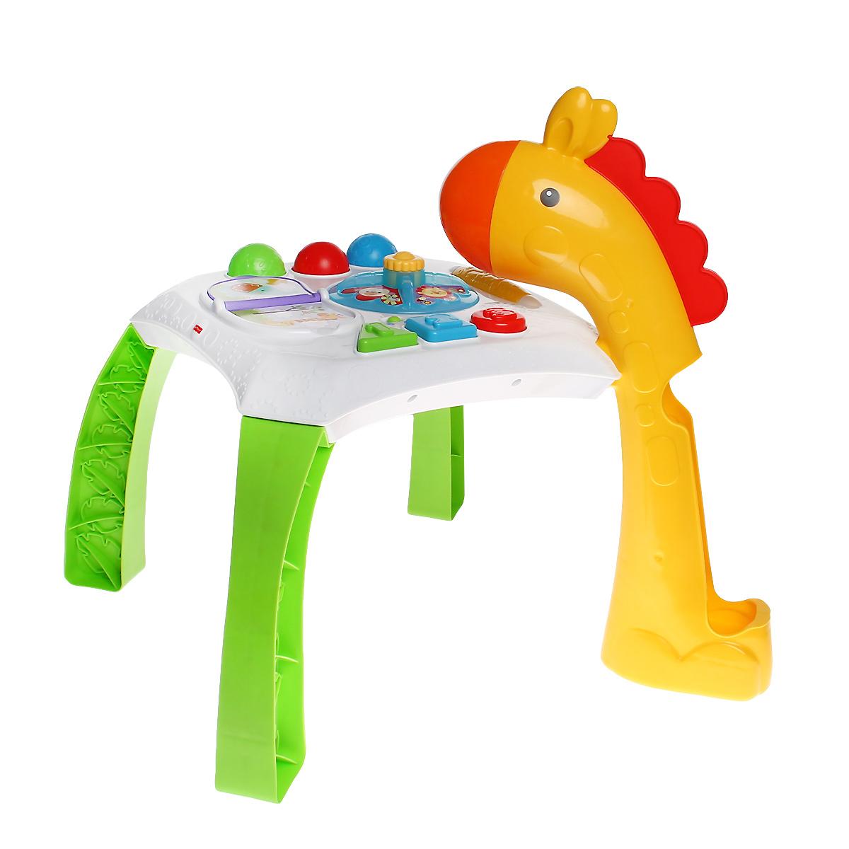Fisher-Price Обучающий столик Веселые животныеCCP66Обучающий столик Fisher-Price Веселые животные со световыми и звуковыми эффектами замечательно подойдет для увлекательных и познавательных игр малыша. Столик представляет собой игровую платформу, к которой крепятся четыре широкие ножки, одна из которых представляет шею жирафа. В ней имеется небольшое отверстие, в которое ребенок сможет опускать один из трех ярких шариков, входящих в комплект, и наблюдать, как они скатываются вниз. На столешнице расположены четыре развивающий элемент, имитирующий книжку с веселыми рисунками, небольшая крутящаяся платформа с забавными зверятами, барабан-погремушка и три разноцветные кнопки в виде геометрических фигур с цифрами от 1 до 3. Действия малыша активируют функции игрушки. Малыш может листать книжку, нажимать на кнопки или раскручивать животных, чтобы активировать огоньки, звуки или музыку. Также в столешнице имеются специальные углубления для трех водящих в комплект шариков. Ребенку понравится изучать столик сидя, а по мере...