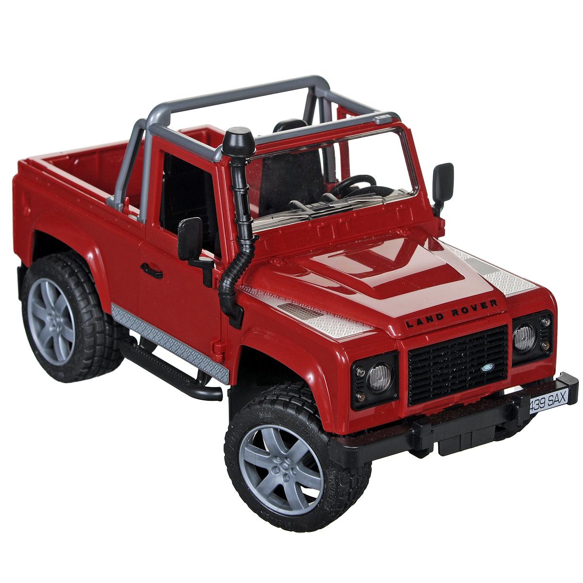 Bruder Внедорожник Land Rover Defender02-591Внедорожник Bruder Land Rover Defender, выполненный из прочного безопасного материала, отлично подойдет ребенку для различных игр. Машина является уменьшенной копией внедорожника фирмы Land Rover Defender без крыши. С левой стороны проходит выхлопная труба. Капот поднимается и крюком фиксируется в верхнем положении. Задний борт опускается. Задние сиденья снимаются, и внедорожник превращается в удобный автомобиль для перевозки грузов. Передняя и задняя оси оснащены амортизаторами. Также внедорожник оснащен фаркопом. Двери водителя и пассажира открываются и снимаются. В салон помещается небольшая фигурка или игрушка. Передние колеса поворачиваются рулем. Кроме этого, в наборе прилагается дополнительный руль (расположен на днище автомобиля), которым через крышу можно управлять колесами внедорожника. Прорезиненные колеса обеспечивают машине устойчивость и хорошую проходимость. Порадуйте своего ребенка таким замечательным подарком!