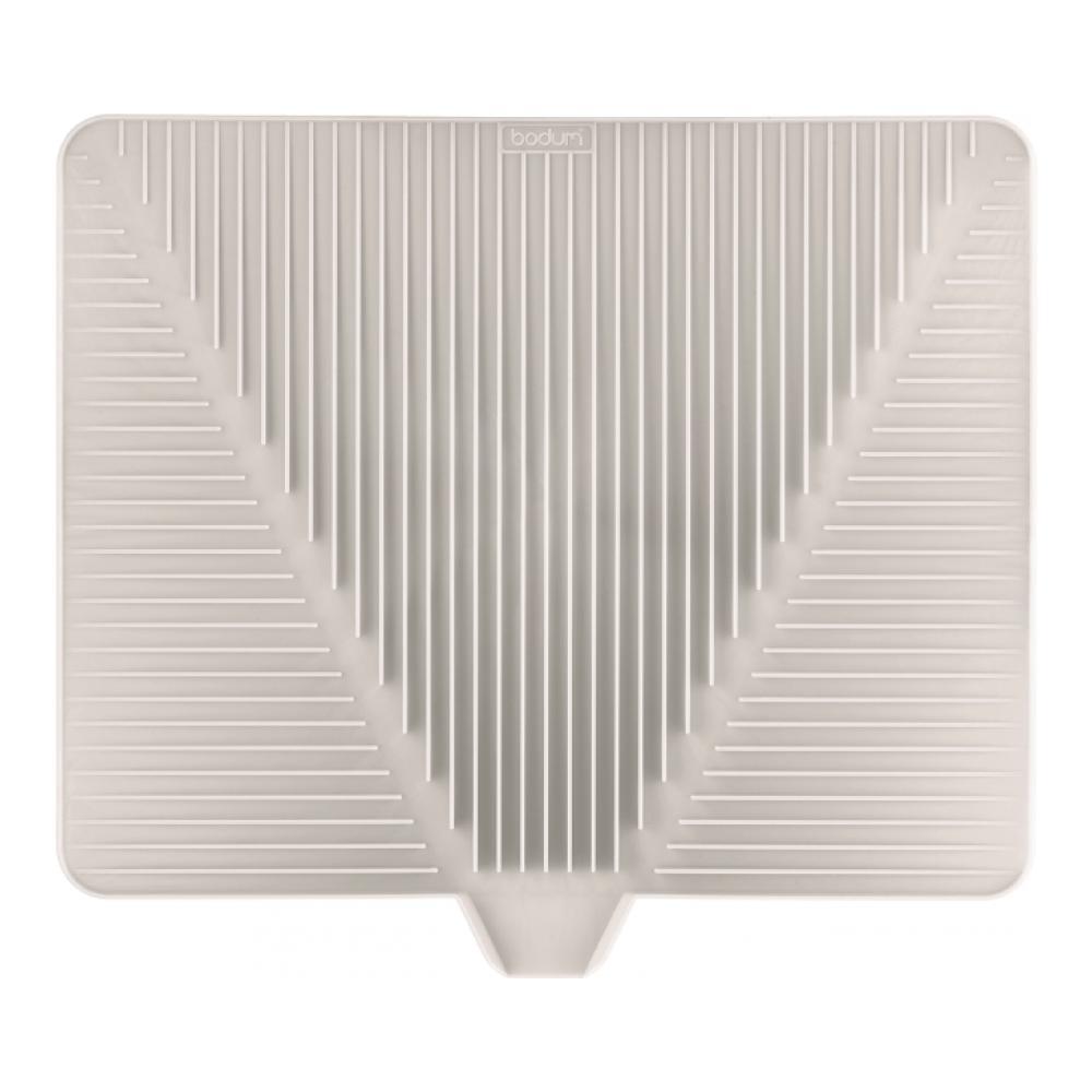 Сушилка для посуды Bodum Bistro, цвет: белый, 38 см х 30 см11548-913Эластичная сушилка для посуды Bodum Bistro, выполненная из гибкого силикона, защитит кухонную столешницу от влаги. Благодаря ребристой поверхности, которая расположена под наклоном, вода стекает в одну сторону. Направьте боковой носик в раковину и вода будет стекать туда. Если рядом раковины нет, то используйте обратную сторону сушилки, которая будет просто собирать воду внутри. Ваша посуда высохнет быстрее, если после мойки вы поместите ее на легкую, современную сушилку. Сушилка для посуды Bodum Bistro станет незаменимым атрибутом на вашей кухне.