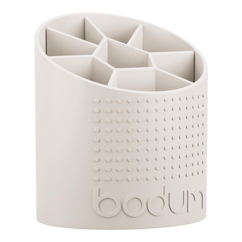 Подставка для кухонных принадлежностей Bodum Bistro, цвет: белый11551-913Подставка для кухонных принадлежностей Bodum Bistro выполнена из высококачественного пластика и оснащена вставкой-разделителем с 8 секциями. Ее легко и удобно переносить благодаря рифлению на корпусе. Благодаря своей компактности подставка занимает минимум полезного пространства на кухонной столешнице или шкафчике. Легко моется как вручную, так и в посудомоечной машине. Размер подставки (ДхШхВ): 12,7 см х 14,5 см х 17 см. Минимальная высота: 11 см. Максимальная высота: 17 см.