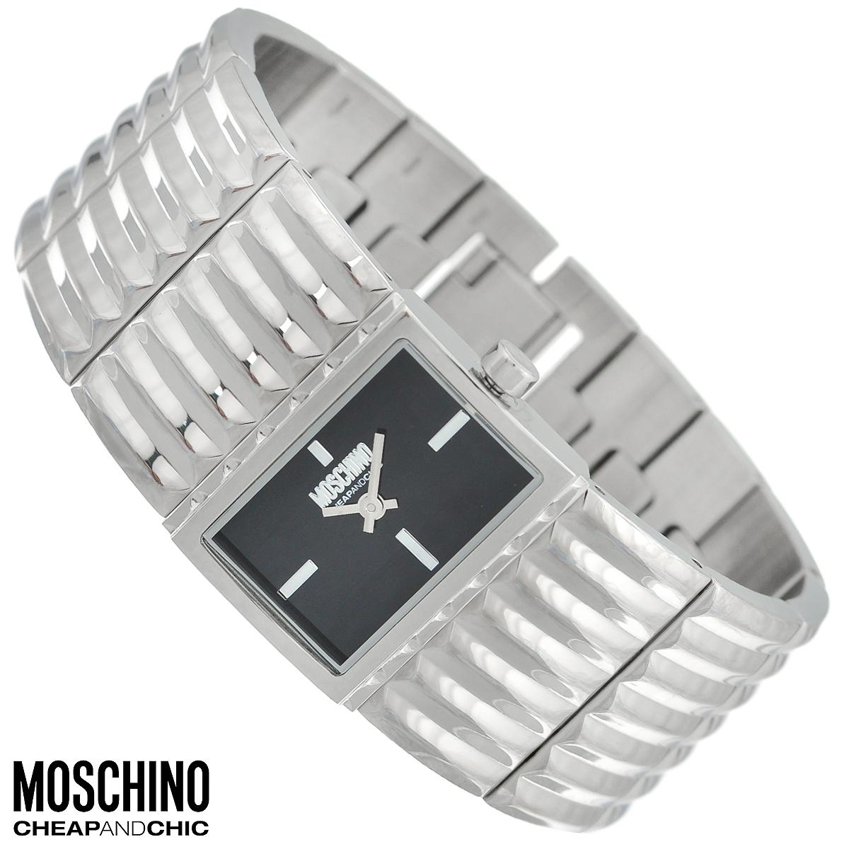 Часы женские наручные Moschino, цвет: серебристый. MW0364MW0364Наручные часы от известного итальянского бренда Moschino - это не только стильный и функциональный аксессуар, но и современные технологи, сочетающиеся с экстравагантным дизайном и индивидуальностью. Часы Moschino оснащены кварцевым механизмом. Корпус выполнен из высококачественной нержавеющей стали. Циферблат с отметками украшен логотипом бренда и защищен минеральным стеклом. Часы имеют две стрелки - часовую и минутную. Широкий браслет часов выполнен из нержавеющей стали и оснащен застежкой-клипсой. Часы упакованы в фирменную металлическую коробку с логотипом бренда. Часы Moschino благодаря своему уникальному дизайну отличаются от часов других марок своеобразными циферблатами, функциональностью, а также набором уникальных технических свойств. Каждой модели присуща легкая экстравагантность, самобытность и, безусловно, великолепный вкус. Характеристики: Размер циферблата: 2,3 см х 1,5 см. Размер корпуса: 2,8 см х 2 см х 0,7...