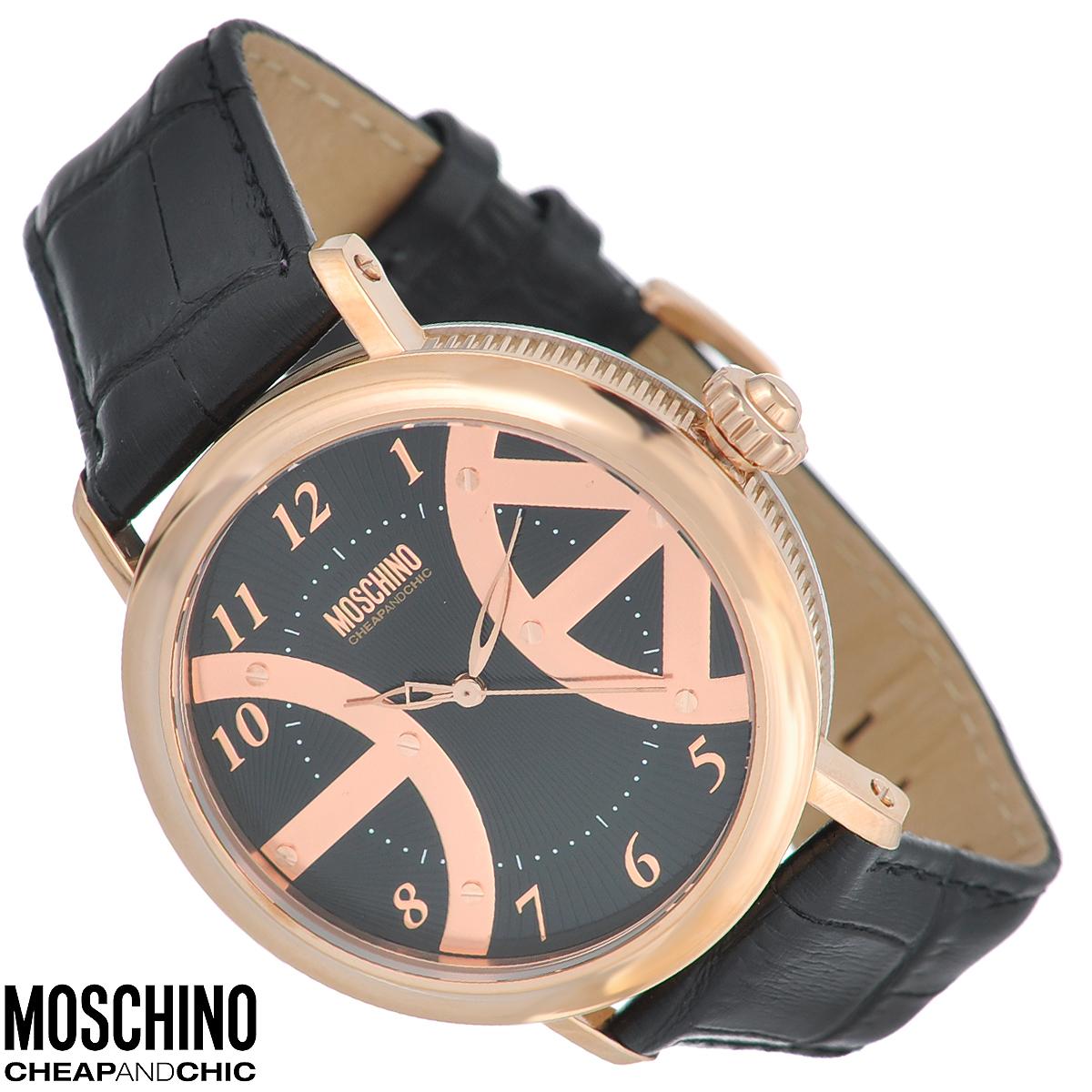 Часы наручные Moschino, цвет: черный, золотой. MW0240MW0240Наручные часы от известного итальянского бренда Moschino - это не только стильный и функциональный аксессуар, но и современные технологи, сочетающиеся с экстравагантным дизайном и индивидуальностью. Часы Moschino оснащены кварцевым механизмом. Корпус выполнен из высококачественной нержавеющей стали с PVD-покрытием. Циферблат с арабскими цифрами оформлен металлическими декоративными элементами и защищен минеральным стеклом. Часы имеют три стрелки - часовую, минутную и секундную. Ремешок часов выполнен из натуральной кожи с тиснением и оснащен классической застежкой. Часы упакованы в фирменную металлическую коробку с логотипом бренда. Часы Moschino благодаря своему уникальному дизайну отличаются от часов других марок своеобразными циферблатами, функциональностью, а также набором уникальных технических свойств. Каждой модели присуща легкая экстравагантность, самобытность и, безусловно, великолепный вкус. Характеристики: Диаметр...