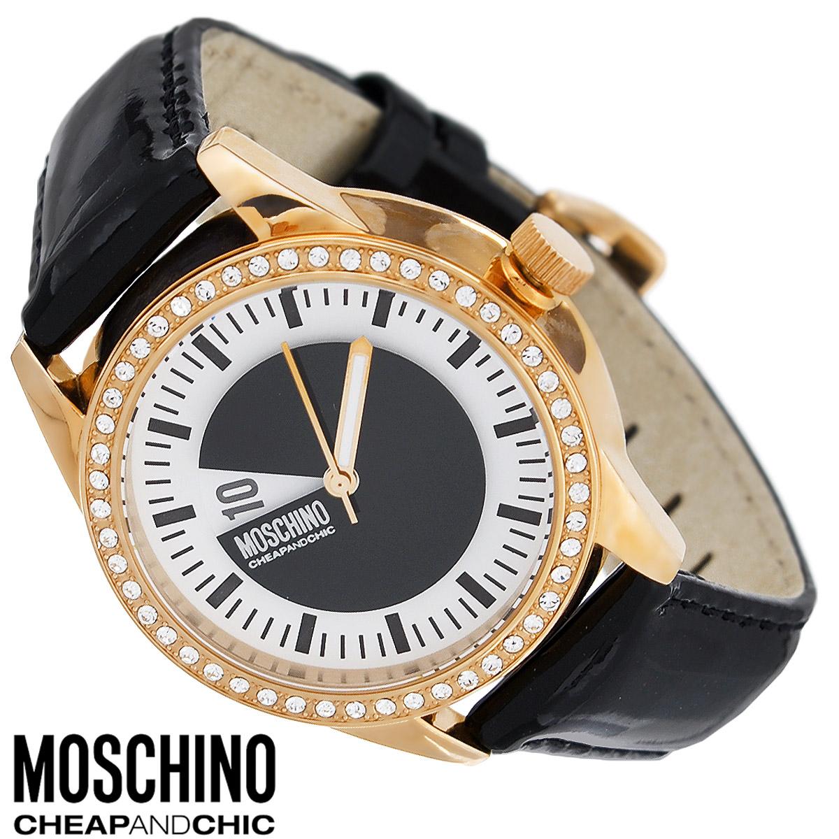 Часы женские наручные Moschino, цвет: черный, золотой. MW0338MW0338Наручные часы от известного итальянского бренда Moschino - это не только стильный и функциональный аксессуар, но и современные технологи, сочетающиеся с экстравагантным дизайном и индивидуальностью. Часы Moschino лаконичного дизайна оснащены кварцевым механизмом. Корпус выполнен из высококачественной нержавеющей стали и по контуру циферблата оформлен стразами. Циферблат с арабскими цифрами и отметками защищен минеральным стеклом. Часы имеют две стрелки - часовую и минутную. Ремешок часов выполнен из натуральной лаковой кожи и оснащен классической застежкой. Часы упакованы в фирменную металлическую коробку с логотипом бренда. Часы Moschino благодаря своему уникальному дизайну отличаются от часов других марок своеобразными циферблатами, функциональностью, а также набором уникальных технических свойств. Каждой модели присуща легкая экстравагантность, самобытность и, безусловно, великолепный вкус. Характеристики: Диаметр...